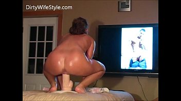 Hot wife fucks dildo while husband watches.