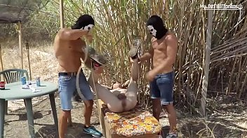 Captive twink gets hosed and fisted outside for 2 merciless doms