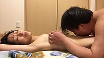 Miyuki writhes under the husband and wife
