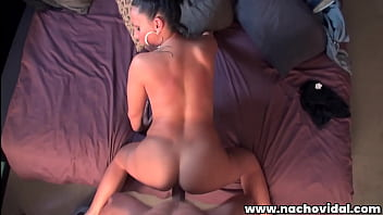 Marta Sanz  kneels and slurps on the Nacho Vidal's cock, squeezing his thick dick between her giant tits, and gets on all fours for a pussy pounding.