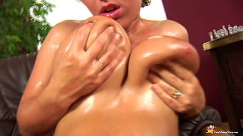 chubby milf shows her oiled monster boobs